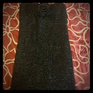 Black with sparkles short dress.
